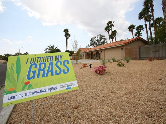 A sign at a home on Racquet Club Drive in Palm Springs lets people know that these residents replaced their lawn with desert landscaping via the Desert Water Agency's turf buy-back program.