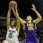 South Carolina Gamecocks guard PJ Dozier (15) and LSU Tigers forward Ben Simmons (25) battle for a rebound in the second half at Colonial Life Arena.