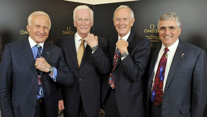 The astronauts Buzz Aldrin, Eugene Cernan, Charles Duke, und Harrison Schmitt, from left, pose with their wristwatches after a press conference at the Omega booth at the world watch and jewellery show 'Baselworld' in Basel, Switzerland, Saturday, March 28, 2009. Omega presented the 'Omega Speedmaster Professional Moonwatch Apollo 11 40th Anniversary Limited Edition' wristwatch in presence of the astronauts.