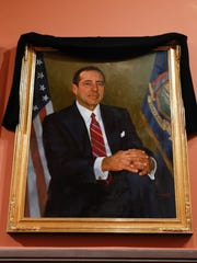 A portrait of former New York Gov. Mario Cuomo hangs in the Hall of Governors at the Capitol on Friday. Cuomo, who served three terms as governor, died Thursday, Jan. 1, 2015, of natural causes due to heart failure, just hours after his son Andrew began his second term as New York's chief executive.