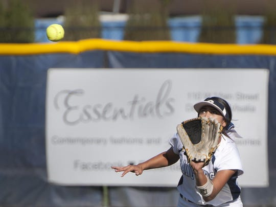 Redwood's Keeley Hernandez takes a fly ball against