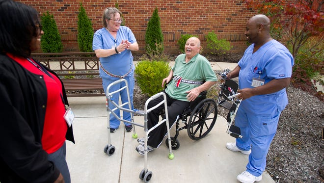 September 2, 2015 - Memphis Jewish Home and Rehab patient Jim DiSalvo, 78, jokes from his wheelchair as he is helped by therapy director Yolanda Holley-Whitmore (from left), physical therapy assistant Debra Forbes and occupational therapist Reggie Hamilton in the therapy garden at the facility's grounds in Cordova. Memphis Jewish Home and Rehab have submitted an application to the board of adjustment to expand their rehabilitation facilities. (Brandon Dill/Special to The Commercial Appeal)