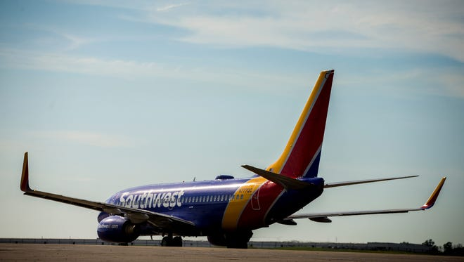 The first Southwest Airlines plane to depart from Cincinnati/Northern Kentucky International Airport prepares for takeoff Sunday, June 4, 2017.