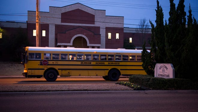 December 3, 2014 - A bus passes Houston High School before dawn. Classes begin at 7 am at HHS.  (Brandon Dill/Special to The Commercial Appeal)