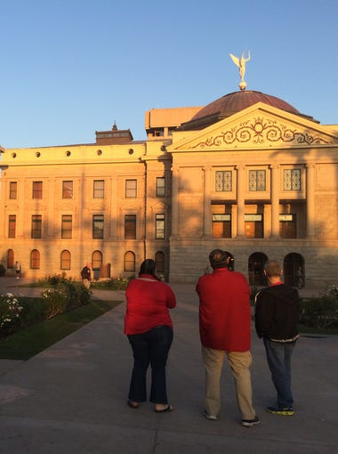 Three teachers from Independence High School in Glendale stand outside the State Capitol after the Senate passed the budget bill that included teacher pay raises on May 3, 2018. The session lasted through the night and to the next morning.