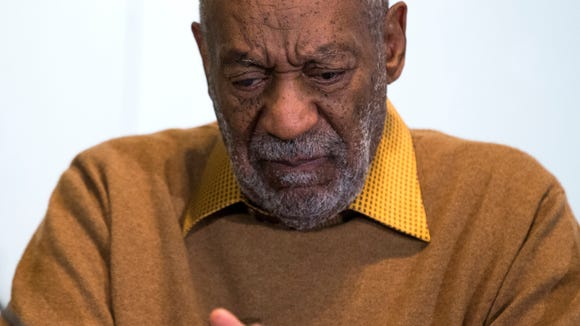 "Entertainer Bill Cosby pauses during a news conference. Cosby's attorney said Sunday, Nov. 16, 2014 that Cosby will not dignify ""decade-old, discredited"" claims of sexual abuse with a response."