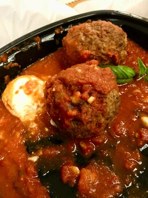 Meatballs with a dollop of ricotta, delivered from Capone's Coal Fired Pizza in Fort Myers.