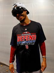 Boston Red Sox right fielder Mookie Betts (50) celebrates after clinching the American League East with a win over the New York Yankees on Sept. 20, 2018.