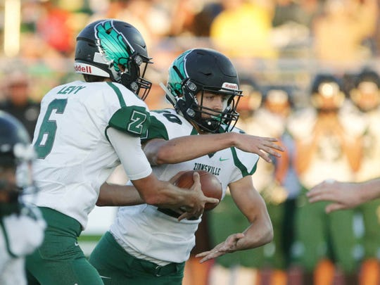 Zionsville's QB, No. 6, Blake Levy fakes a hand off