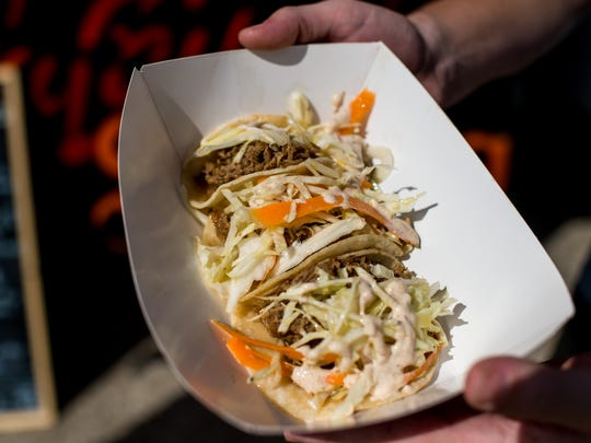 The Jerk Tacos, a pork taco topped with jerk mayo and cabbage and carrot slaw, are served during lunch near the UL campus on West St. Mary Street in , La., Wednesday, Nov. 11, 2015.