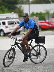 Patrolman Alaric Tucker rides his bike outside of Englewood