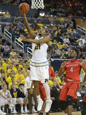 University Michigan Wolverines Zak Irvin scores against the Rutgers Scarlet Knights Jonathan Laurent during second half action on Wednesday January 27 ,2016 at the Crisler Center Ann Arbor MI. Kirthmon F. Dozier/Detroit Free Press