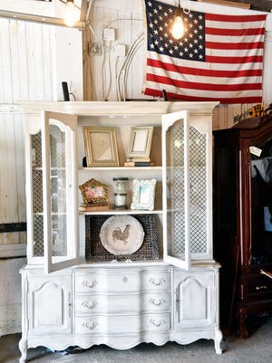 """This wooden hutch in Sheryl Kline's York Township barn is the refinished piece that Kline says grabbed attention and jumpstarted her furniture restoration work. Since Dec. 2015, Kline has purchased pre-owned wooden furniture pieces from stores such as Re-source York, restored and refurnished them and sold them to clients, contributing some of the profits to various local nonprofits. """"What I do is special, but anybody can do it,"""" Kline said."""