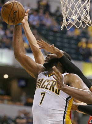 Indiana Pacers center Al Jefferson (7) drove the ball to the basket past multiple Chicago defenders against the in an October game. Pacers opponents are using double teams to prevent him from being a consistent threat in the paint.