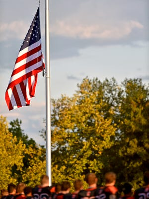 In this file photo, the American flag is raised on a new midfield flag pole sponsored by the Mount Wolf VFW before a YAIAA football game Friday, Sept. 28, 2017, at Northeastern.