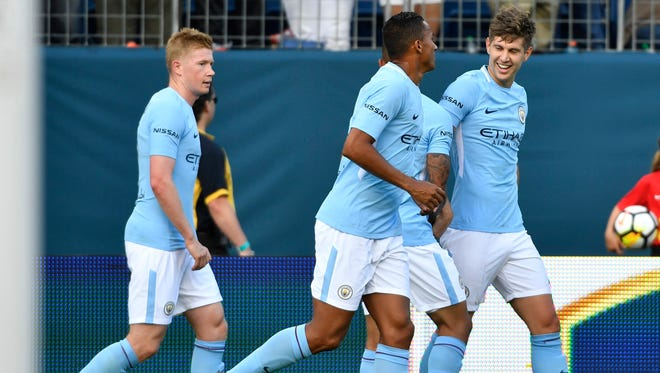 Players celebrate the goal by Manchester City defender John Stones (5) in the first half of the Manchester City-Tottenham game in the International Champions Cup Saturday, July 29, 2017 at Nissan Stadium in Nashville, Tenn.