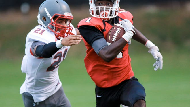 Junior wide receiver Ty Hellams, right, and the Greenville Red Raiders, averaging nearly 47 points through the first three weeks, are 3-0 heading into Friday's game at J.L. Mann.