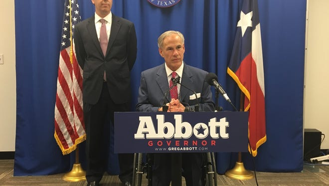 Gov. Greg Abbott announces his intention to appoint Jimmy Blacklock, left, to the Texas Supreme Court on Monday at the Republican Party of Texas headquarters in Austin.
