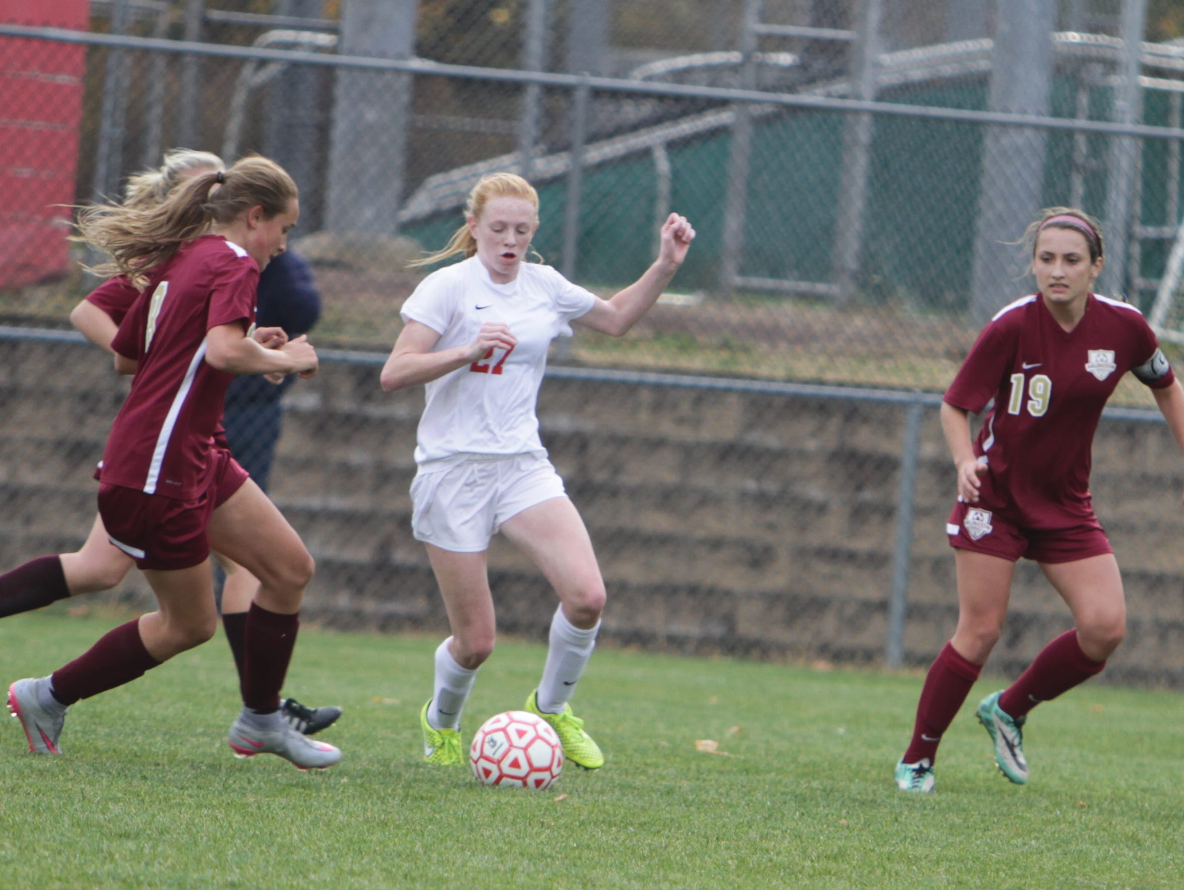 North Rockland's Kelly Brady attempts to dribble through the Arlington defense during a Section 1, Class AA quarterfinal game at North Rockland High School on Tuesday, October 27th, 2015. North Rockland won 2-0.