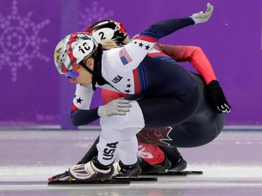 Jessica Kooreman of the United States and Marianne St Gelais of Canada collide during their women's 1500 meters short track speedskating heat in the Gangneung Ice Arena at the 2018 Winter Olympics in Gangneung, South Korea, Saturday, Feb. 17, 2018. (AP Photo/Julie Jacobson)