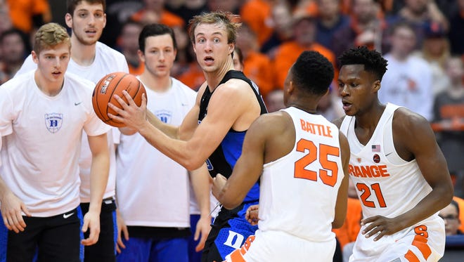 Duke Blue Devils guard Luke Kennard (5) controls the ball as Syracuse Orange guard Tyus Battle (25) and forward Tyler Roberson (21) defend during the second half at the Carrier Dome on Feb. 22.