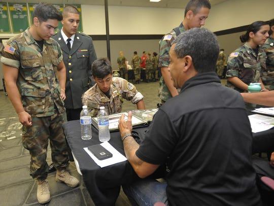 Norbie Lara shows cadets at La Sierra photos of his