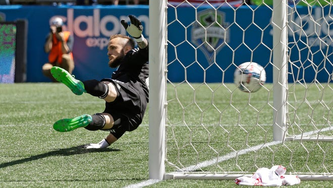 Seattle Sounders goalkeeper Stefan Frei can't stop a penalty kick goal scored by Toronto FC forward Jozy Altidore in the first half of Saturday's MLS match.