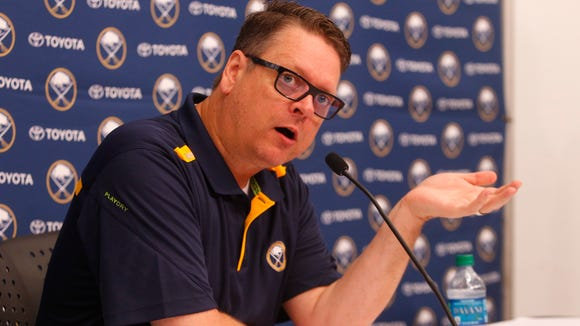 Buffalo Sabres general manager Tim Murray, shown here from a June news conference, said on Tuesday night in Rochester that he wants his AHL affiliate to win.