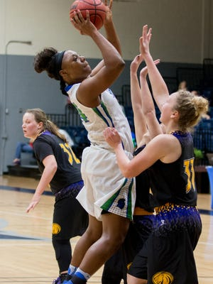West Florida's Toni Brewer (24) jumps to get a shot off over the North Alabama defense Monday night at the University of West Florida.