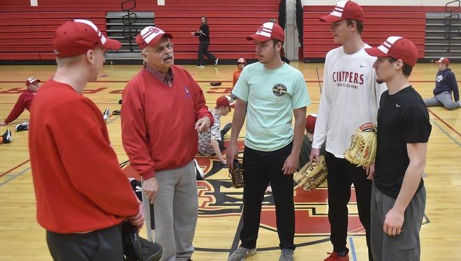 New Sturgeon Bay baseball coach John Berns talks to from left, seniors Tanner DeGrave, Jaeger Brusky, Jared Van Bramer and Anthony Moore during practice Thursday.