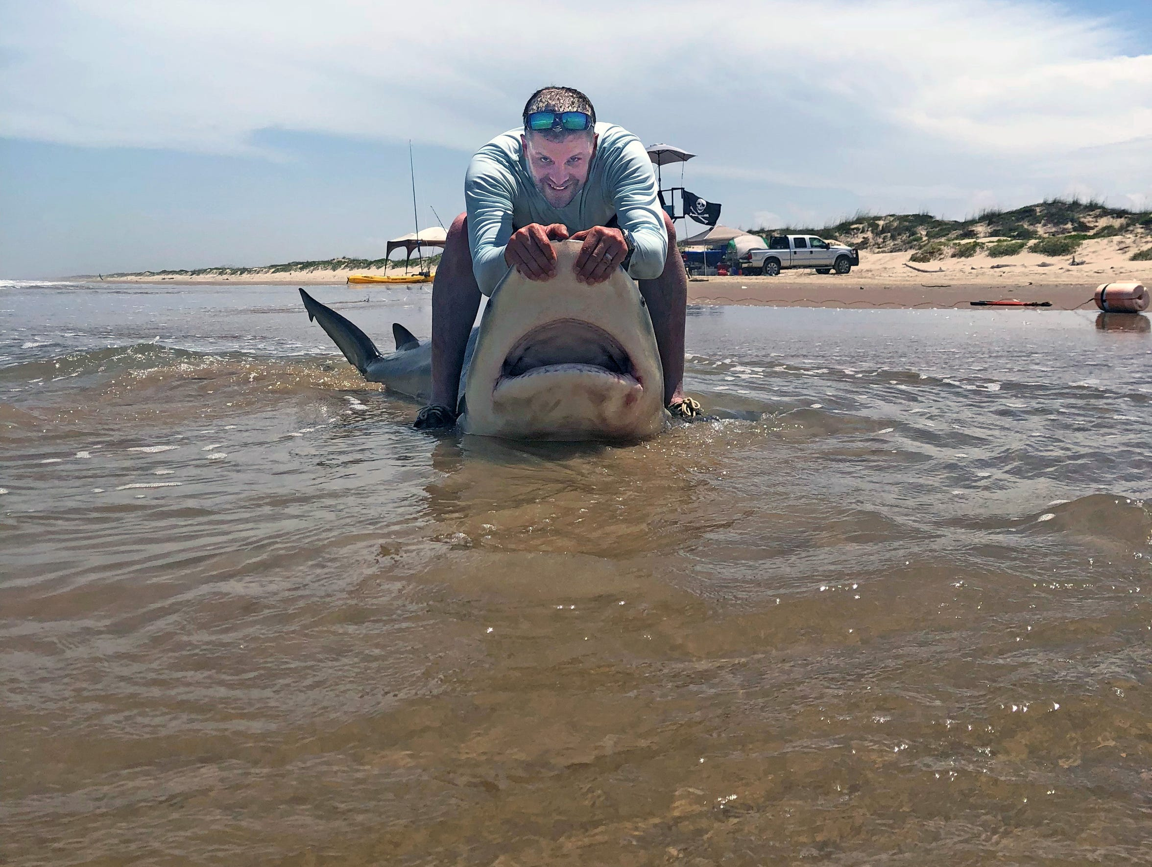 The shark was released after the fishermen snapped photos of it.