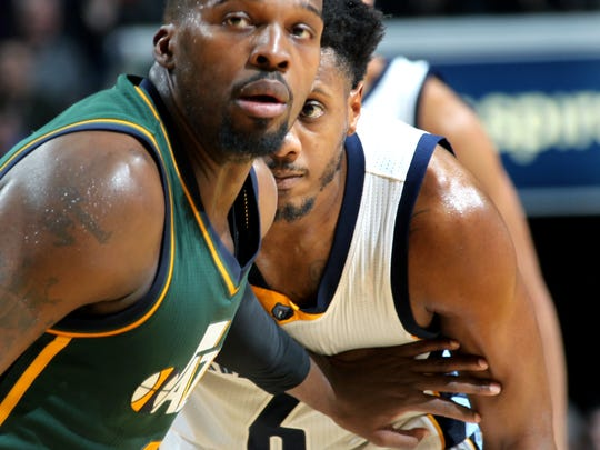 March 4, 2016 -  Memphis Grizzlies Mario Chalmers, right, gets close on defense to Utah Jazz Shelvin Mack at the FedExForum.