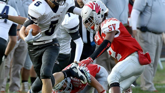 Fairless' Conner Durant stiff arms Sandy Valley's Demetrius Evans in the first half.