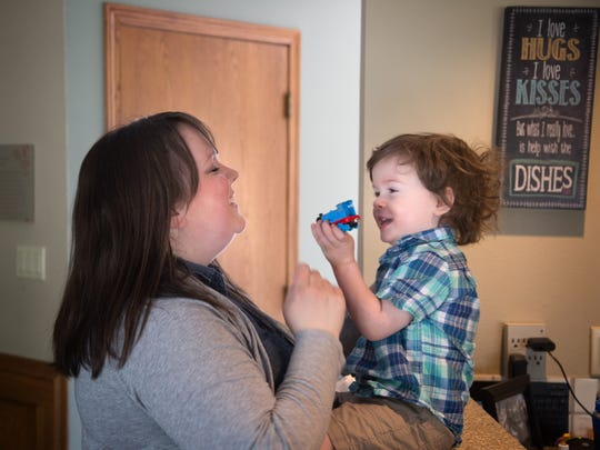 Kelli Schoney and her son Clark, 2, play at their home