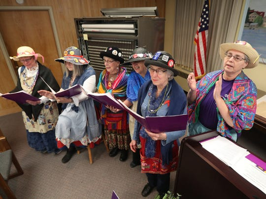 The Rochester Raging Grannies perform during a dedication of a marker in honor of Delia Phillips who became the first woman in Le Roy to vote, 100 years ago. The marker was placed at the Le Roy Municipal Building during an April 2, 2018 ceremony.
