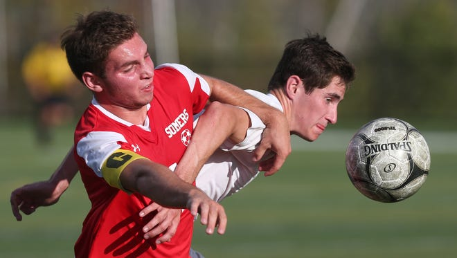From left, Somers John Riina (11) and Brewster's Daniel Hasa (7) battle for ball control during boys soccer game at Brewster High School Sept. 27, 2017. Somers won the game 1-0.
