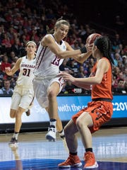 Gonzaga star Jill Barta drives to the hoop during action
