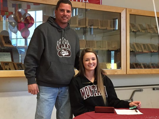 Mayghan McGrath with her dad, Keith McGrath, signs a letter of intent to play college softball at the University of Montana on Nov. 8, 2017, at South Salem High School.