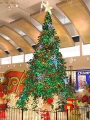 Christmas shopping season officially is in full swing as the tree at Westland Shopping Center gets customers in the holiday spirit in this file photo.