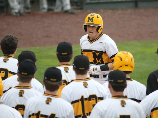 McQuaid's Ben Beauchamp is greeted by teammates after