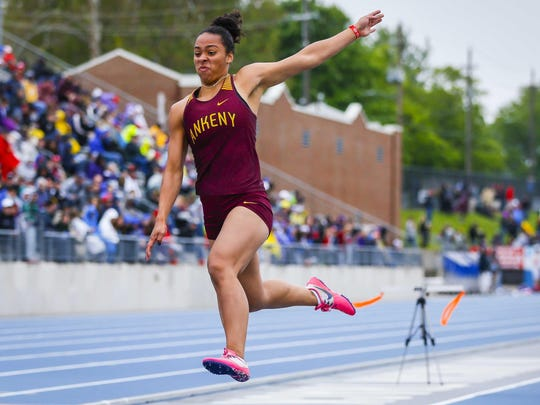 Ankeny's Jasmine Rumley competes in the long jump during