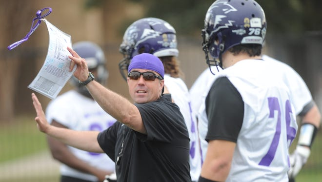 First-year ACU coach Adam Dorrel works with an offensive lineman during the Wildcats' first spring practice Tuesday, Feb. 28, 2017 at the Wally Bullington Practice Facility.