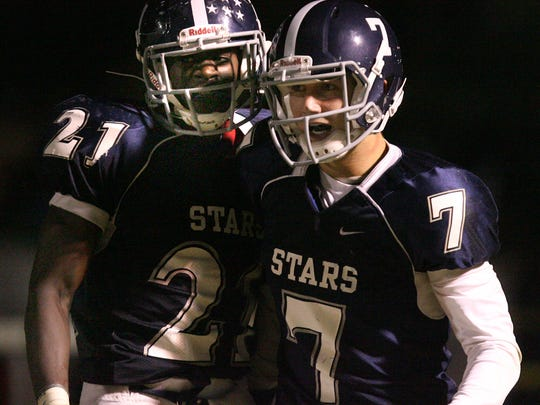 Siegel quarterback Brent Stockstill (7)  is congratulated by Denzel Harding after scoring a touchdown agaiinst Riverdale during a 2012 contest. Stockstill will be part of the school's inaugural Hall of Fame class.