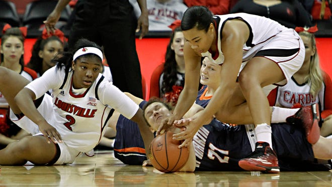 Louisville forward Mariya Moore, right, goes after a loose ball as does Tennessee-Martin's Jessy Ward (21) after it got away from Louisville's Myisha Hines-Allen (2) and Tennessee-Martin's Katie Schubert in first half action in their NCAA college basketball game in Louisville, Ky., Sunday, Nov. Nov. 16, 2014. (AP Photo/Garry Jones)