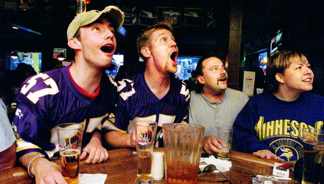 Vikings fans cheer on the team while enjoying the game at J.D. Beamers on the corner of University Drive and Ninth Avenue in 1999.