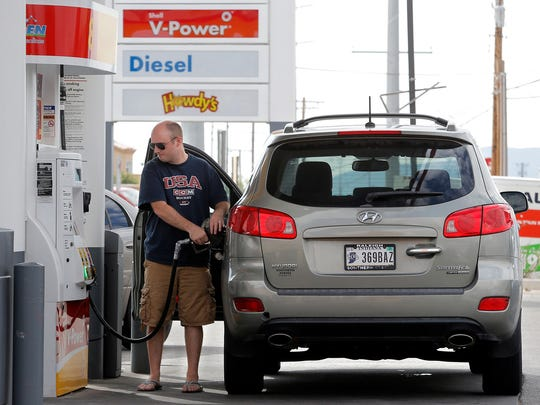 East El Paso resident Charles Stargel fills up at the Shell station at Saul Kleinfeld and Montana Ave. Friday where gas was at $2.029. Gas prices are expected to dip below the $2.00 mark.