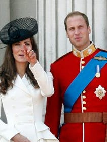 Britain's Prince William, Duke of Cambridge, right, his wife Catherine, Duchess of Cambridge, react on the balcony of Buckingham Palace after returning from the Trooping the Colour ceremony to mark the Queen's official birthday in London, in this, June 11, 2011, file photo. Among the roughly 5 million visitors expected in New York this holiday season, at least two are certain to get the royal treatment: Britain's Prince William and his wife, Kate. They're due to arrive Sunday for the first trip either has made to the United States' biggest city, and William also is set to visit the nation's capital for the first time.