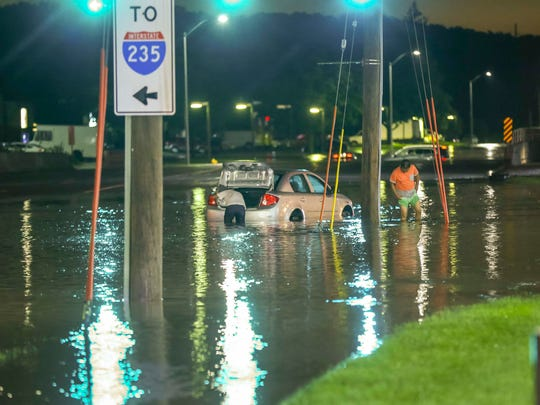 Street flooding from Walnut Creek at the intersection of 73rd St & University Ave in Windsor Heights, Iowa, after heavy rain Saturday, June 30, 2018.