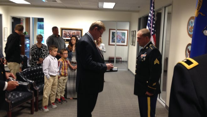 Sgt. Jon Wright received his Bronze Star with V device for valor from U.S. Rep. Mark Amodei, R-Carson City, on May 22,