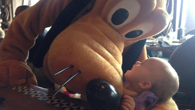 Isabella is in awe of Pluto after he snuck up from behind and put his arm around her.